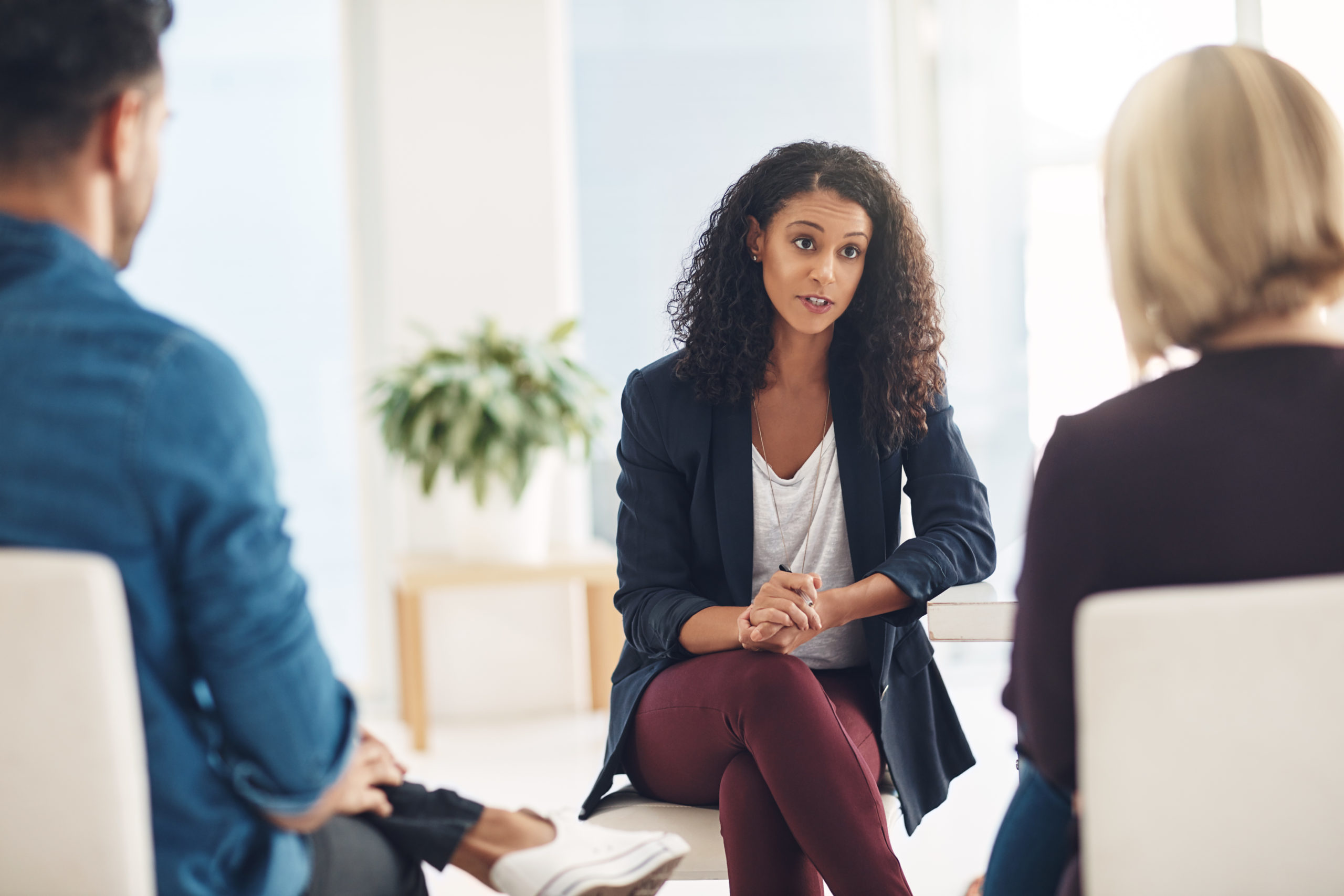 Clinical mental health counselor in group therapy session