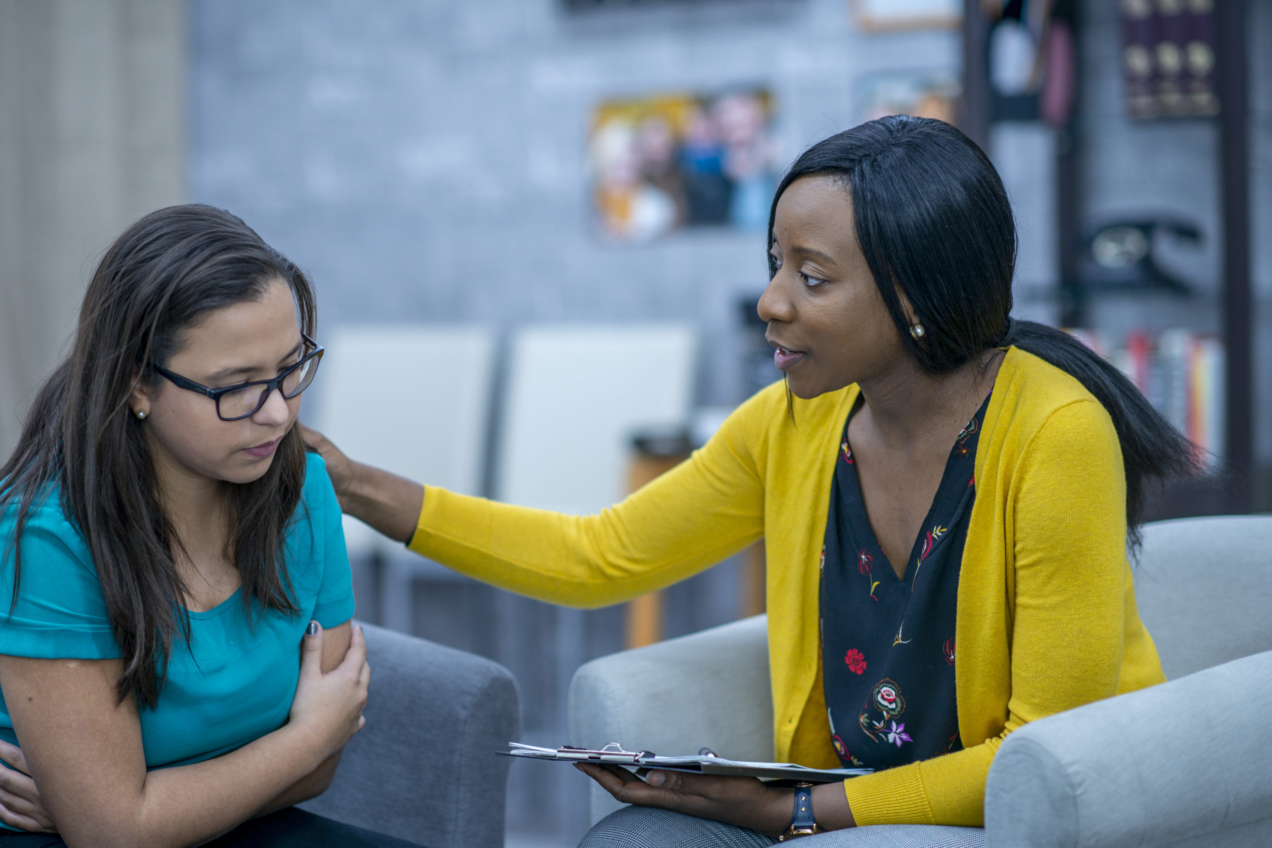 Clinical mental health counselor counsels female client