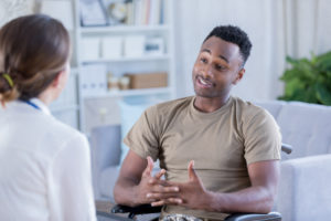 Clinical mental health counselor listens to a male client speak