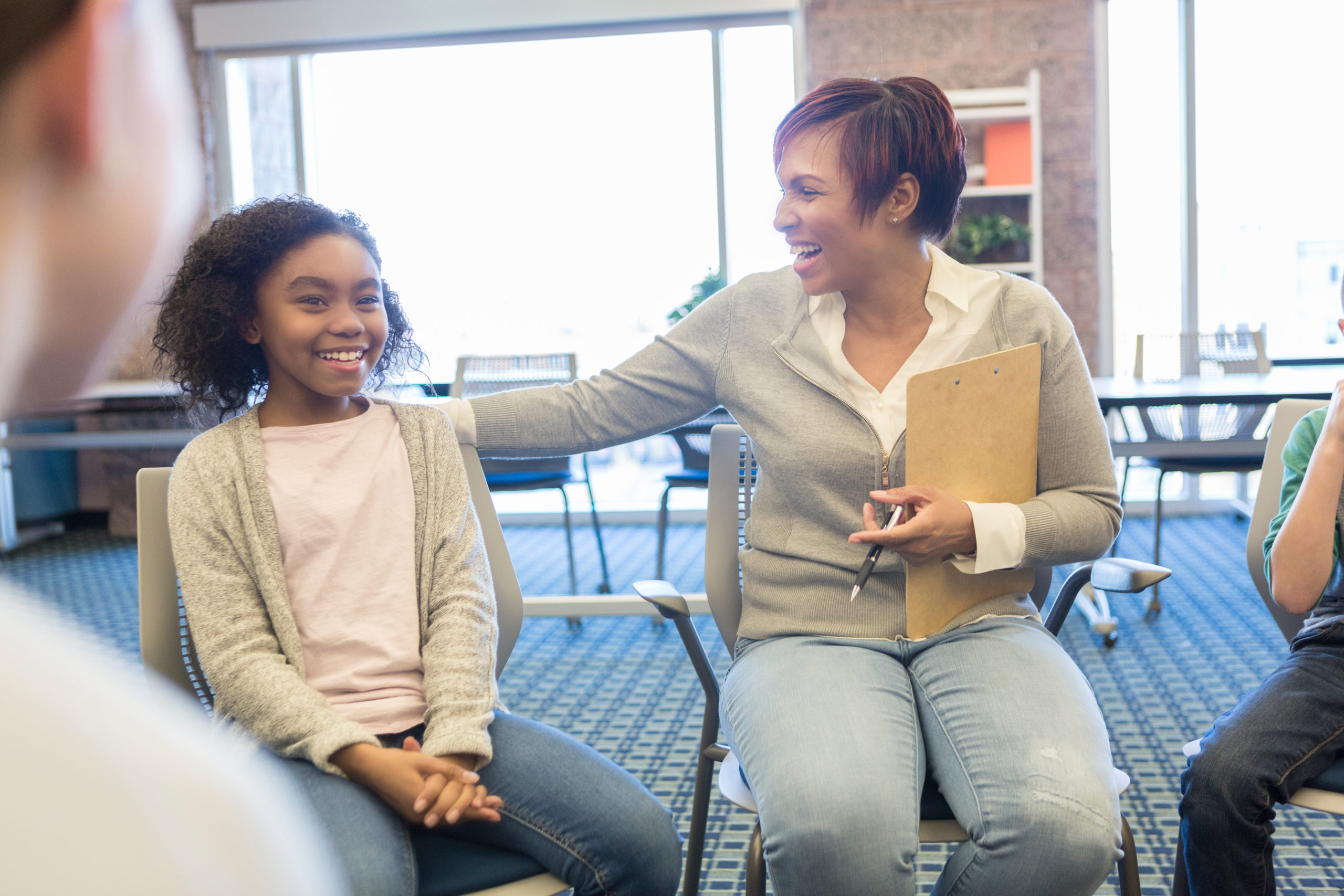 School counselor laughs with students