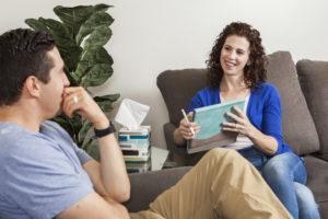 A health & wellness coach coaches a client