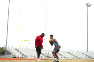 A sport performance specialist works one-on-one with an athlete
