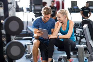 Individual with a PhD conducts human and sport performance research in a gym