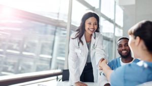 Healthcare leader with a PhD meets other providers