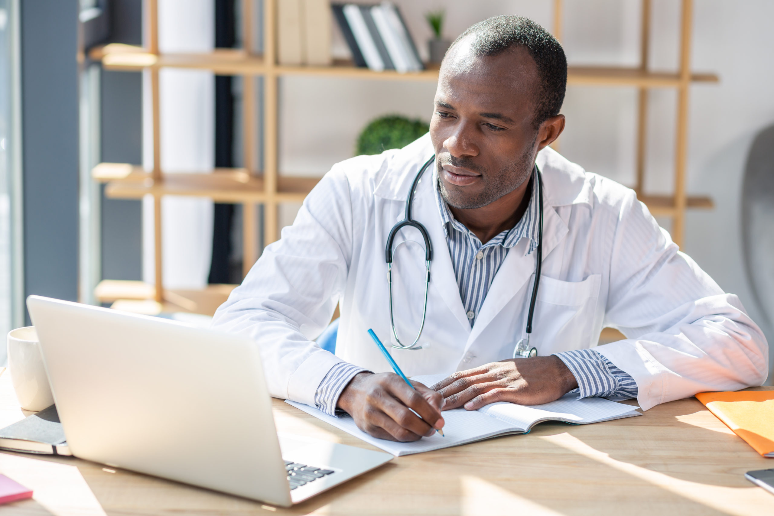 Healthcare provider with PhD writes about research
