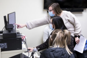 master of science in speech-language pathology faculty and students using voice equipment