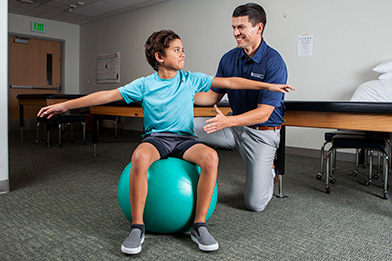 PT works with young boy